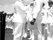 Admiral Chester W. Nimitz pins Navy Cross on Doris Miller, at ceremony on board warship in Pearl Harbor, May 27, 1942