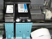 Two cartridges (one with black ink, one with colored inks) installed in an inkjet printer