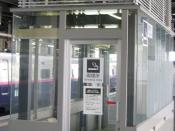 English: An enclosed smoking area in a Japanese train station. Note air ventilation.