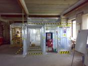 English: This is a typical asbestos enclosure constructed by Trinitas Contracts in the UK for the removal of asbestos sprayed coating from beams.