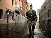 82nd Airborne Division paratrooper patrols the streets of New Orleans in September 2005.