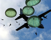 The Army 82nd Airborne Division, from Fort Bragg, N.C., performs a mass jump with 120 members during the 56th annual Department of Defense 2006 Joint Service Open House (JSOH) hosted at , .