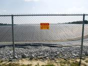 English: A radiation warning sign on the fence outside the restricted area at the Maxey Flat Low Level Radioactive Waste site in Maxey Flat, Kentucky, USA.