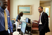 English: President Barack Obama his personal aide Reggie Love share a laugh in his personal secretary office in the White House, June 24, 2009. Personal secretary Katie Johnson (personal secretary) is in the background.