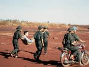 Viet Cong soldiers carry a litter with injured American POW, Capt. David Earle Baker, (captured 27 June 1972) from the hospital tent to the release point. American and South Vietnamese prisoners were exchanged for Viet Cong and North Vietnamese prisoners.