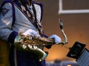English: Some marching bands have their members hold music on lyres attached to the instrument.