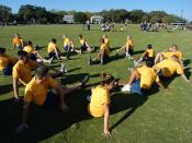 English: Naval Air Station (NAS) Pensacola (Mar. 2, 2004) - Naval Junior Reserve Officers Training Corps (NJROTC) cadets from Boca Raton Community High School, Fla., stretch before a track and field event. Boca Raton NJROTC was participating in the 2004 N