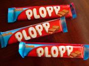English: Three Plopp candy bars in their wrappers.