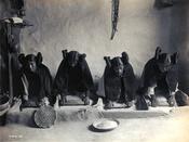 Four young Hopi Indian women grinding grain