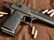 English: A IWI Desert Eagle with a aftermarket magazine surrounded by Magnum Research 50AE JHP bullets.