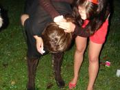 A drunk woman vomits, during a party in Zagreb and a friend helps her.