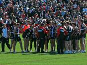 Coach Ross Lyon (centre) addresses the St Kilda Football Club players, an Australian Football League (AFL) team. At training at the Moorabbin Oval in Melbourne the Tuesday before the 2009 AFL Grand Final.