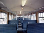 Inside a Class 312 driving trailer open before refurbishment. For second class passengers these trains had 3+2 high-back seating. The passengers behind the driver were able to enjoy the driver's view of the route ahead through the windows between the cab