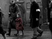 Schindler sees a little girl wearing a red coat. The red coat is one of the few instances of color in the black-and-white scenes of the film.