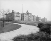 English: University of Cincinnati, Ohio. c.1904. Looking up a hill toward buildings.
