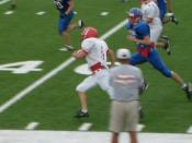 English: Chance Baize running for a touchdown against Claud
