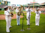 Musicians from the U.S. Navy perform The Star-Spangled Banner prior to a baseball game in Boston