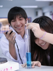 English: KIS International School IB Diploma students conducting a Science experiment.
