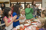 English: CORPUS CHRISTI, Texas (Sept. 9, 2011) Fifth and sixth-grade students at Blaschke Sheldon Elementary School applaud Capt. Gina M. Jaeger, commanding officer of Naval Health Clinic Corpus Christi, during a hero's lunch honoring local military and a