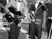 English: Bill Haley (in front) and lead guitarist Franny Beecher (right) during a concert in Essen, Germany, in 1958. Deutsch: Bill Haley (mitte) und Gitarrist Franny Beecher (rechts) während eines Konzertes in Essen im Jahre 1958.