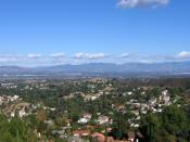 English: View of the San Fernando Valley from southwestern edge in the Santa Monica Mountains above Woodland Hills, Los Angeles. The San Gabriel Mountains are in the distant background.
