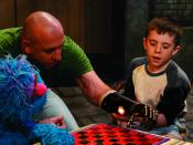English: Sgt. Sebastian Cila demonstrates his new robotic hand on the Sesame Street special