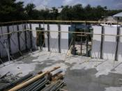English: The interior AFTER the concrete has been poured into the walls, with the bracing in place.