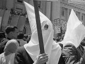 English: Ku Klux Klan members supporting Barry Goldwater's campaign for the presidential nomination at the Republican National Convention, San Francisco, California, as an African American man pushes signs back.