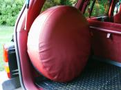 English: Spare tire (full size) mounted in the cargo space area in a 1993 Jeep Grand Cherokee