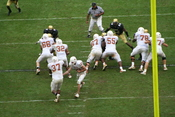 Running back Henry Melton (#37) receiving the handoff and rushing the ball for the Texas Longhorns