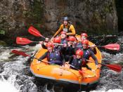 English: Whitewater Rafting You will be lucky not to get wet.