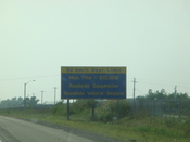 English: Speeding fine ($10 000) warning on Highway QEW in Ontario