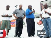 Madden, Mississippi postmaster Bulus Leflore, 2nd from right, receives a copy of Madden NFL 07 and an Xbox 360 from NFL greats, Jerry Rice, right and Marshall Faulk, left, Warren Moon, center, Tuesday, August 22, 2006 as part of Maddenoliday in Madden, Mi
