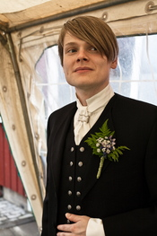 An Icelandic man wearing the hátíðarbúningur formal national costume