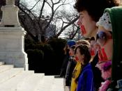 Members of Bound4LIFE in Washington, D.C. symbolically cover their mouths with red tape.