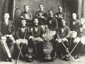 The Montreal Hockey Club (Montreal Amateur Athletic Association) win the first Stanley Cup. The large trophy behind the Stanley Cup is the Amateur Hockey Association of Canada championship trophy.
