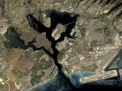 Pearl Harbor naval base. The West Loch the green-tinted area on the left side of the image.