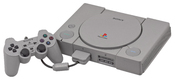 English: A Sony PlayStation (SCPH-5001), shown with a DualShock controller and Memory Card. This is the JPG version. Deutsch: Ein Sony PlayStation Spielkonsole (SCPH-5001), mit einem DualShock Gamecontroller und Speicherkarte angezeigt. Dieses ist die JPG