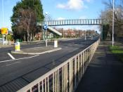 English: Sutton: A217 Glastonbury Road footbridge The footbridge enables pedestrians to get from one side of the A217 Reigate Avenue to the other. The footbridge is marked on the OS 1:50,000 scale mapping, and Glastonbury Road is to the left. (You should