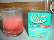Alka-Seltzer Plus dissolved in water.