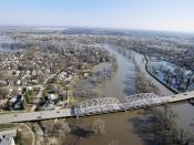 English: Grand Forks, ND, May, 1997 -- Aerial view of Grand Forks neighborhood and a bridge crossing the flooded Red River of the North. The levees that were protecting the city are breeched, flooding the area near the river. FEMA/Michael Rieger