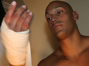 A fighter wraps his hands prior to putting gloves on.