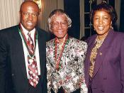 Congressman Edlophus Towns (left) and his wife, Gwen Towns (right) pose with former Congresswoman and Brooklyn native, Shirley Chisholm (center)