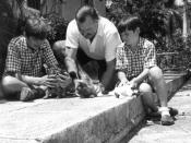 American Author Ernest Hemingway with sons Patrick (left) and Gregory (right) with kittens in Finca Vigia, Cuba.