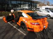 English: Ralph Lauren getting in his orange Porsche 997 GT3 RS after talking with us for a while.