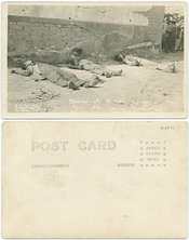 Bodies of 3 men lying as they fell after being executed.