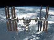 English: The International Space Station is featured in this image photographed by an STS-134 crew member on the space shuttle Endeavour after the station and shuttle began their post-undocking relative separation. Undocking of the two spacecraft occurred