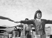 Camp life at Manzanar: Female internees practicing calisthenics, 1943.