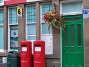 English: Double vision? There is no obvious reason why the Post Office in Dunkeld Street, Aberfeldy needs identical twin post boxes. At least there is a third box alongside for junk mail.
