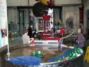 English: Water Zone, Enginuity, Coalbrookdale One of the 10 museums in the Ironbridge Gorge, Enginuity provides hands-on Science experiments for children. This section encourages children to work together to maintain water flow using dams, an archimedes s